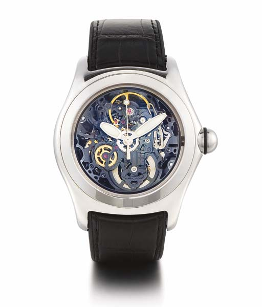 CORUM. A STAINLESS STEEL SKELETONISED TONNEAU-SHAPED AUTOMATIC WRISTWATCH WITH CENTRE SECONDS