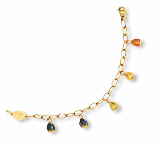 AN ENAMEL AND GOLD CHARM BRACELET, BY FABERGE