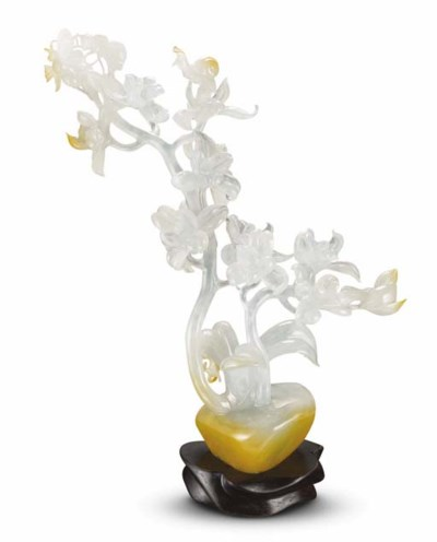A CARVED JADEITE ORCHID