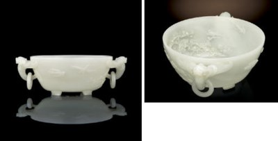 A FINELY CARVED WHITE JADE BOW
