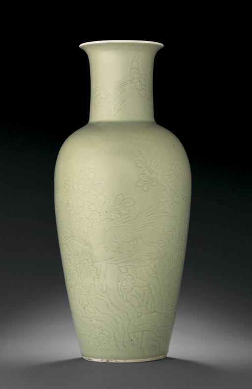 A FINE AND RARE CARVED CELADON