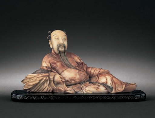 A WELL-CARVED SOAPSTONE FIGURE