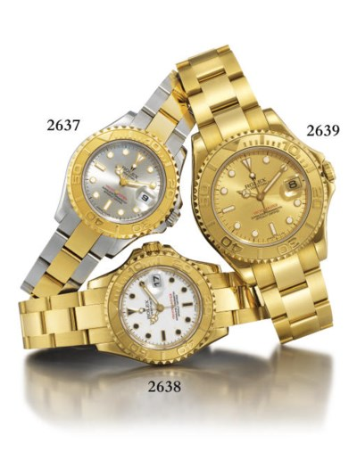 ROLEX. AN 18K GOLD MID-SIZE AU