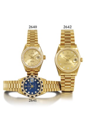 ROLEX. A MID-SIZE 18K GOLD AND