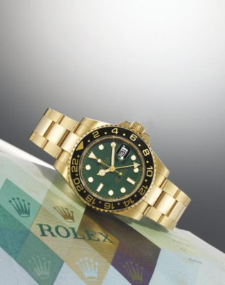ROLEX. AN 18K GOLD AUTOMATIC T