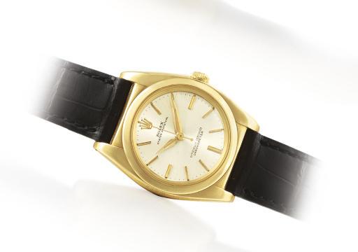 ROLEX. A 14K GOLD AUTOMATIC WR