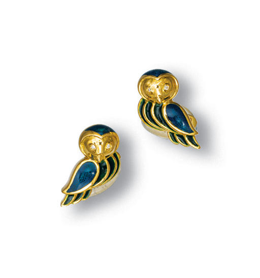 A PAIR OF ENAMEL AND GOLD CUFF