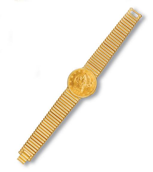 AN 18K GOLD TEN DOLLAR COIN WA