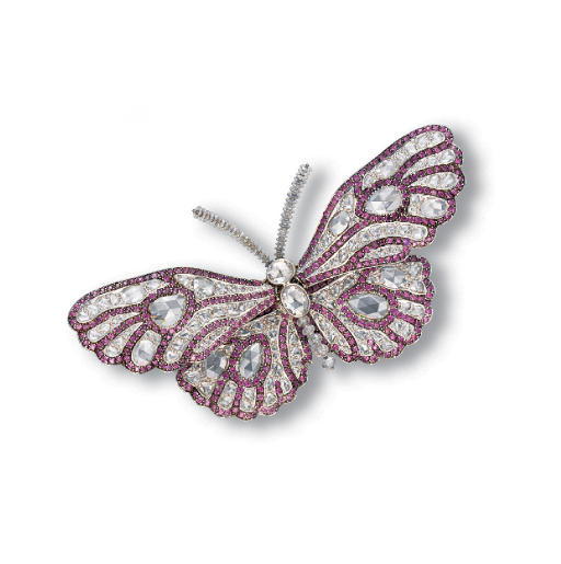 A DIAMOND AND RHODOLITE GARNET BUTTERFLY CLIP BROOCH, BY CARNET