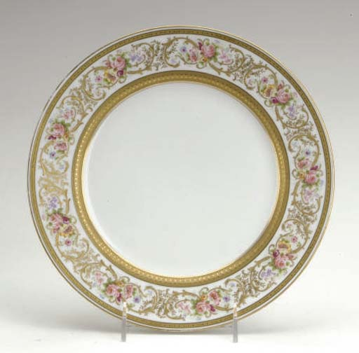 A SET OF ELEVEN LIMOGES GILT AND PAINTED DINNER PLATES,