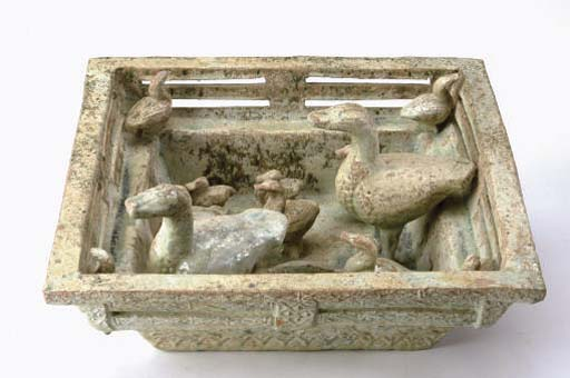 A CHINESE GREEN-GLAZED RED POTTERY MODEL OF A DUCK POND,