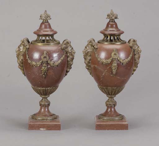 A PAIR OF GILT-BRONZE MOUNTED ROUGE MARBLE LIDDED URNS,