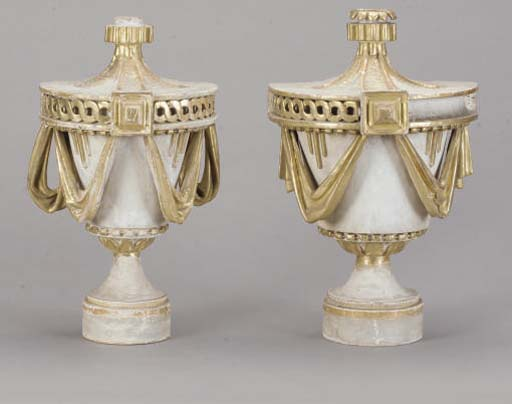 A PAIR OF ITALIAN WHITE-PAINTED AND PARCEL-GILT DECORATED URN FORM FINIALS,