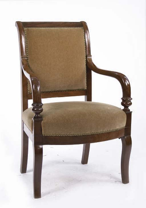 AN EMPIRE MAHOGANY FAUTUEIL COVERED IN TAUPE VELVET,
