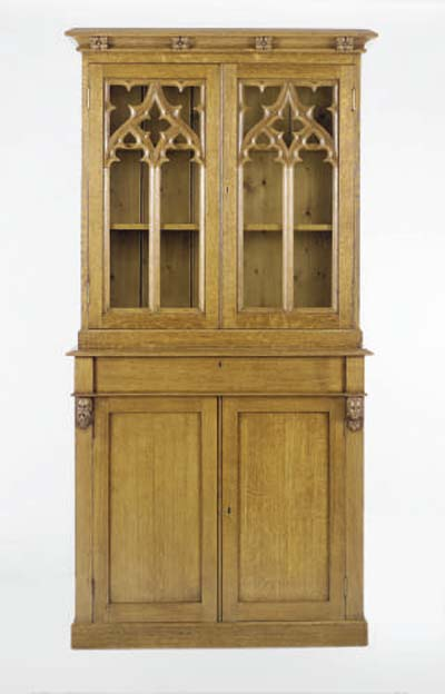 A VICTORIAN GOTHIC REVIVAL OAK LIBRARY CABINET,