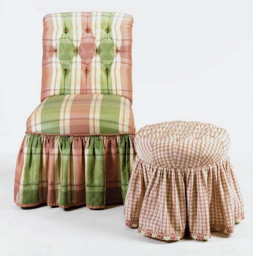 A BUTTON TUFTED PLAID UPHOLSTERED SLIPPER CHAIR WITH A CHECK UPHOLSTERED STOOL,