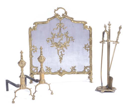 A PAIR OF BRASS ANDIRONS, A FIRESCREEN, TWO FIRE TOOLS AND A MATCHING STAND,