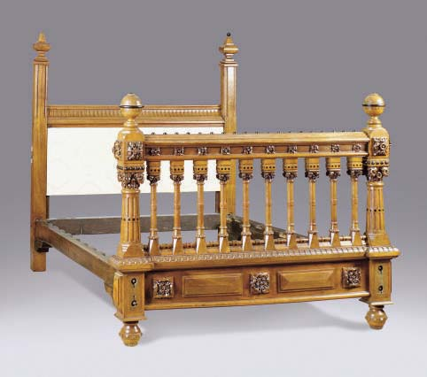AN ENGLISH AESTHETIC MOVEMENT OAK AND EBONIZED BED,