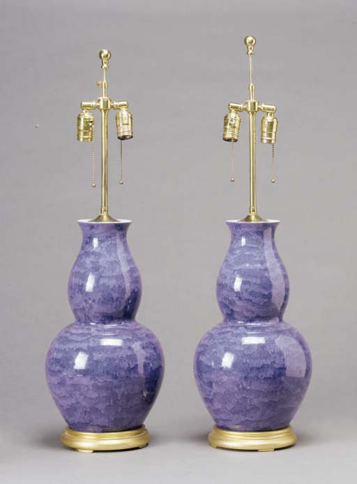 A PAIR OF BLUE GLAZED DOUBLE GOURD VASES MOUNTED AS LAMPS,