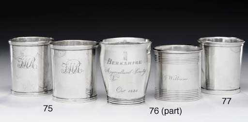 A GROUP OF FOUR SILVER BEAKERS