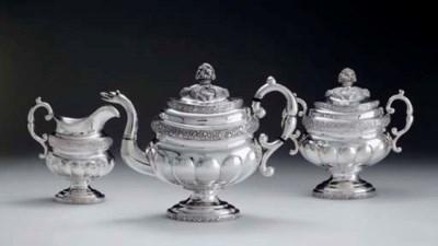A SILVER THREE-PIECE TEA SET
