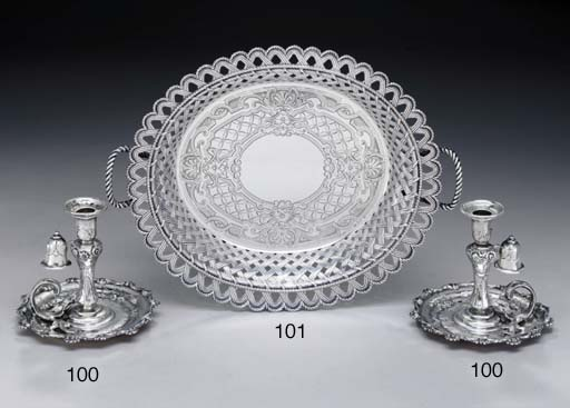 A PAIR OF SILVER CHAMBER CANDL