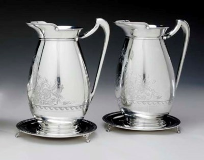 A PAIR OF SILVER EWERS WITH ST
