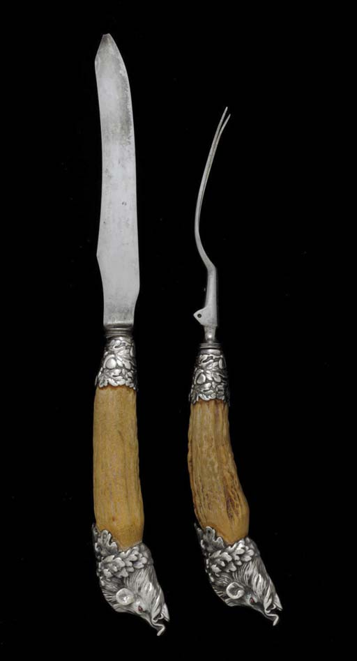 A SILVER AND ANTLER CARVING SE