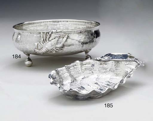A SILVER OYSTER-FORM DISH