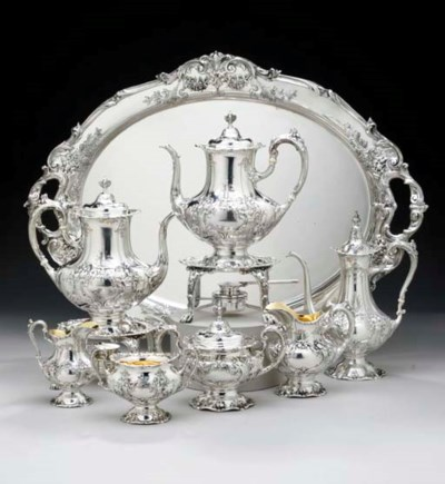 A SILVER SEVEN-PIECE TEA AND C