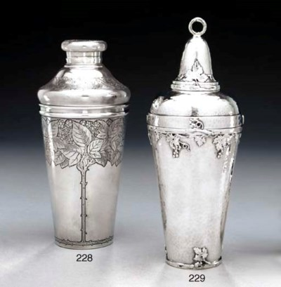 A SILVER COCKTAIL SHAKER