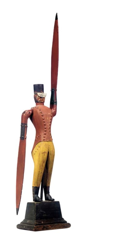 A CARVED AND PAINTED SOLDIER W