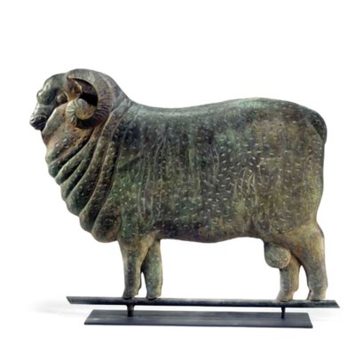 A MOLDED AND GILT COPPER RAM W