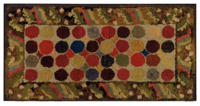 A COTTON AND WOOL HOOKED RUG