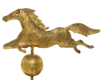 A GILT MOLDED COPPER JUMPING H