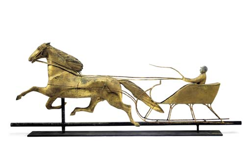 A GILT MOLDED COPPER HORSE AND SLEIGH WEATHERVANE