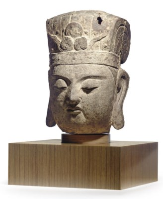 A LARGE CHINESE CAST IRON HEAD
