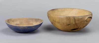A LARGE HANDLED TREENWARE BOWL
