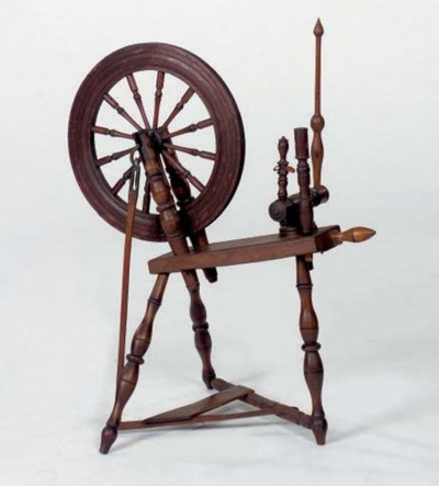 A STAINED OAK SPINNING WHEEL,