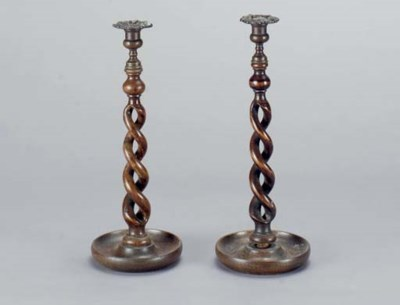 A PAIR OF TURNED OAK CANDLESTI