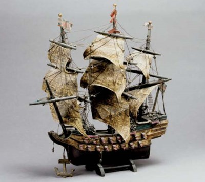A PARCEL-GILT AND WOODEN MODEL