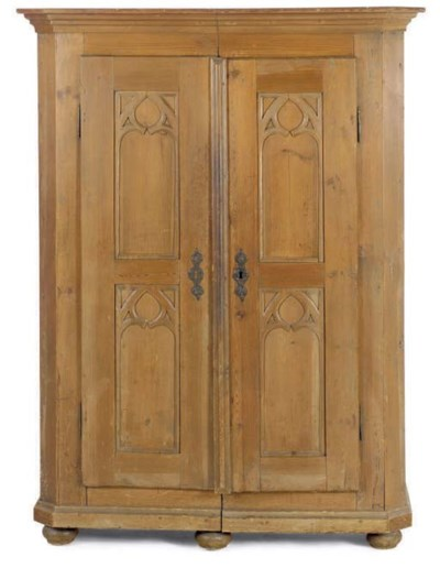 A GOTHIC PINE ARMOIRE,