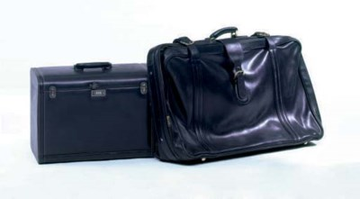 TWO BLACK LEATHER TRAVEL CASES
