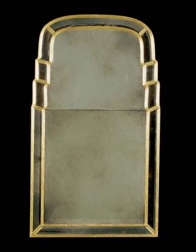 A GILTWOOD ARCHED MIRROR,