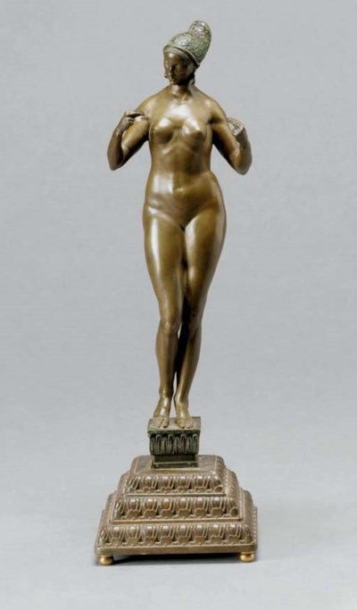 A PATINATED BRONZE FIGURE OF N