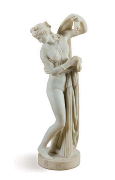 A WHITE MARBLE FIGURE OF A LAD