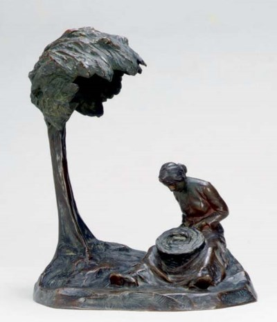 A PATINATED BRONZE INKWELL,