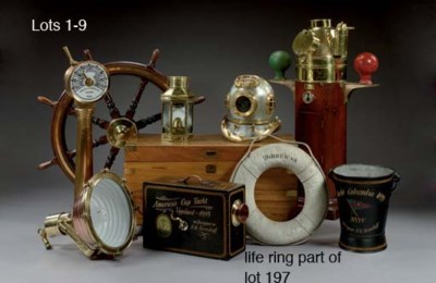 A mahogany and brass eight spo