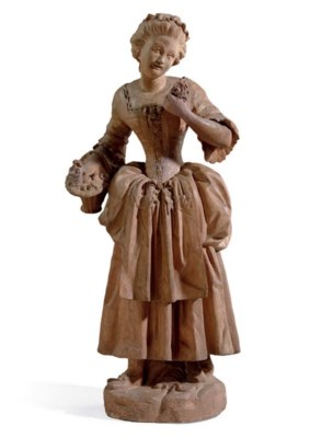 A TINTED PLASTER FIGURE OF A W