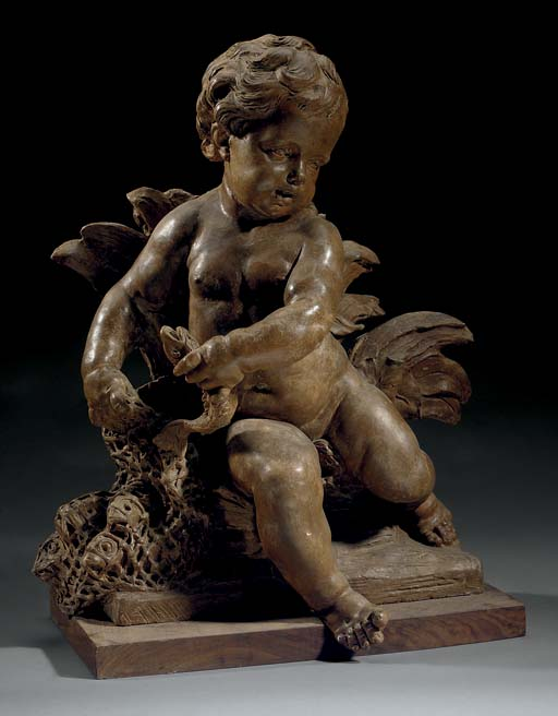 A TERRACOTTA GROUP OF A PUTTO